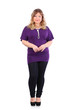Smiling beautiful woman wearing violet t-shirt stands isolated