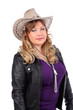 Beautiful woman wearing cowboy hat and leather jacket isolated