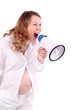 Pregnant woman in white shouts into megaphone isolated on white