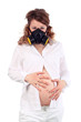 Pregnant woman in white and respirator holds belly isolated
