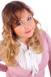 Young beautiful woman in pink blouse looks at camera isolated