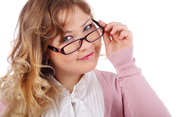 Smiling beautiful woman in glasses looks at camera isolated