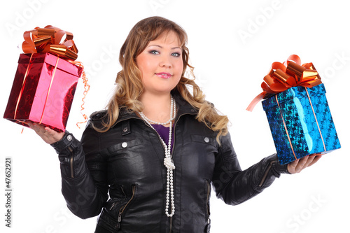 Beautiful woman wearing leather jacket holds boxes with gifts