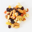 Handful of nuts, dried fruits and candied fruits on white