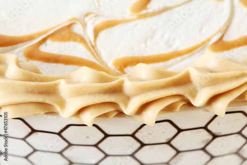 caramel and cream decorations at appetizing festive cake