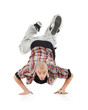 Breakdancer stands on hands and looks at camera isolated