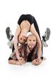 Smiling ballerina does bridge and bald breakdancer lies on floor