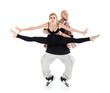 Breakdancer holds ballerina in black and stands on tiptoes