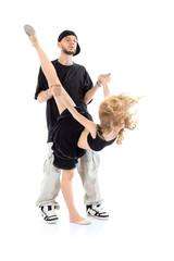 Rapper holds hands of gymnast girl in black dress