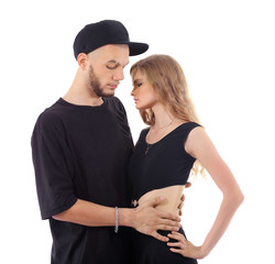 Rapper wearing black t-shirt and hat hugs graceful girl isolated