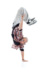 Breakdancer stands on one hand and points up isolated
