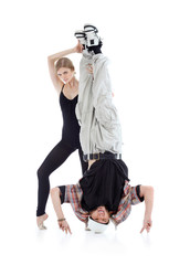 Graceful gymnast holds breakdancer legs isolated on white