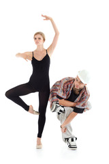 Graceful ballerina and breakdancer in helmet poses isolated