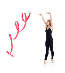 Beautiful ballerina in black suit with red ribbon stands
