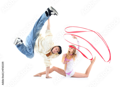 Young breakdancer stands on one hand and leg held up