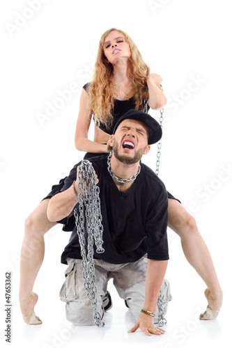 Graceful girl in black sits on papper back and tames his chain