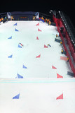Competitors ride snowboard at artificial ramp poster