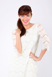 Beautiful young woman wearing in white openwork dress laughs. poster