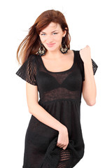 Sexy girl in black dress and bid earrings smile