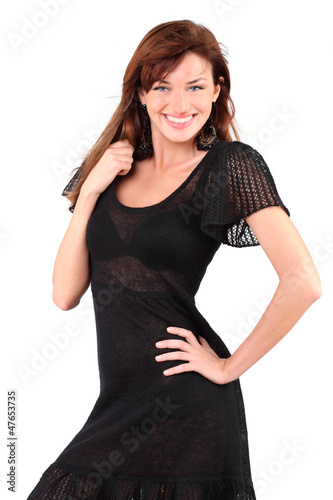 Beautiful girl in black dress and bid earrings smiles