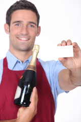 Man holding business card