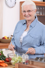 Senior woman preparing salad