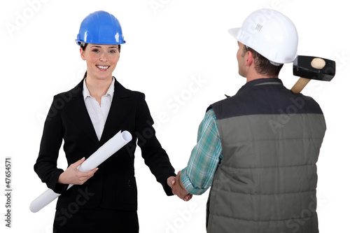 Architect shaking builders hand