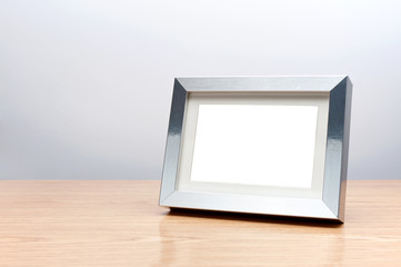 Blank silver picture frame on the table with clipping path
