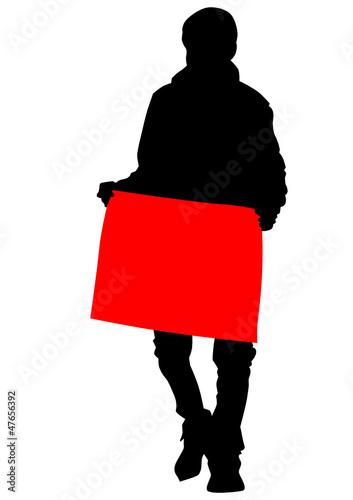 Man and cardboard banner