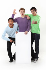 Young friends gathered around poster