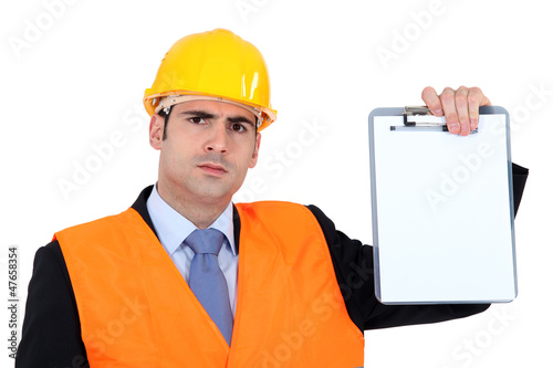 angry businessman holding a clip board