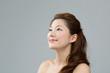 Beautiful asian woman on gray background
