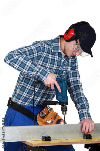 craftsman working with a drill