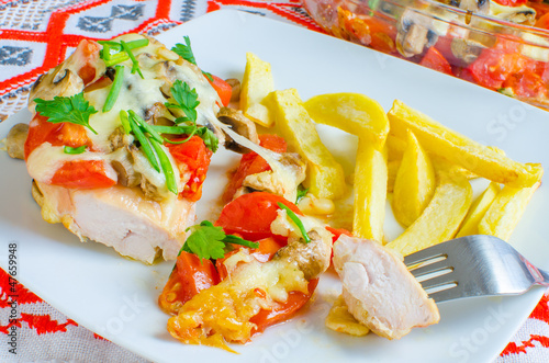Chicken breasts baked with tomatoes and mushrooms