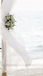 fresh white flowers as wedding decoration on beach isolated over
