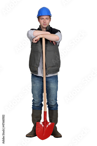 Man stood with shovel