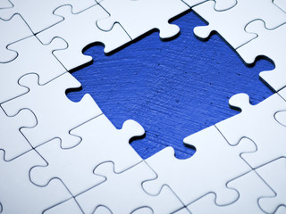 White jigsaw with missing pieces