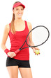 A young female tennis player holding a racket and ball