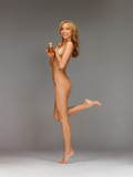 healthy naked woman with oil bottle