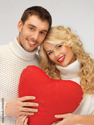 family couple in a sweaters with heart