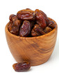 dried dates in a wooden bowl