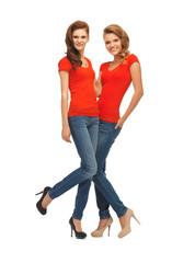 two beautiful teenage girls in red t-shirts