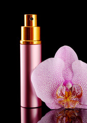 women's perfume in beautiful bottle and orchid flower,