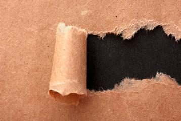Torn kraft paper background