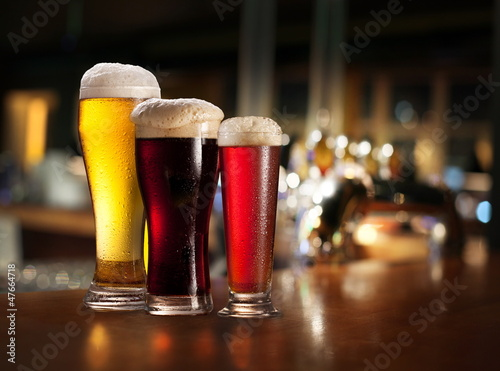 Glasses of light and dark beer. Poster