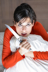 Frightened woman alone at home