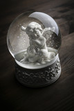 Fototapety snow globe with snow flakes and angel