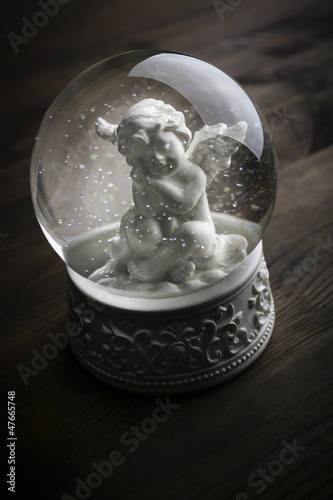 snow globe with snow flakes and angel