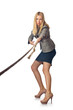 Businesswoman in tug of war concept