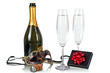 Bottle of champagne with two flutes and party mask